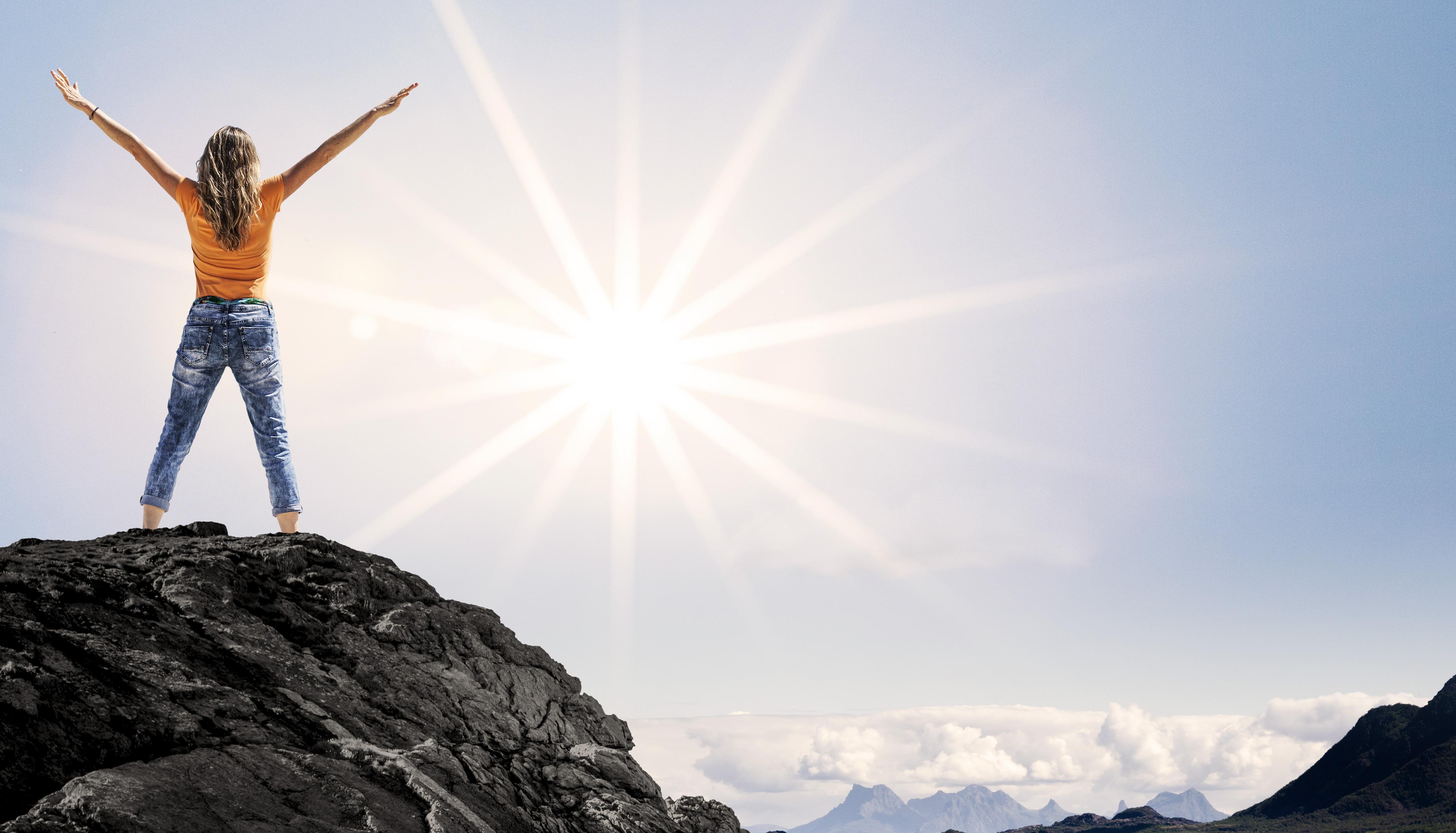 Frau am Gipfel