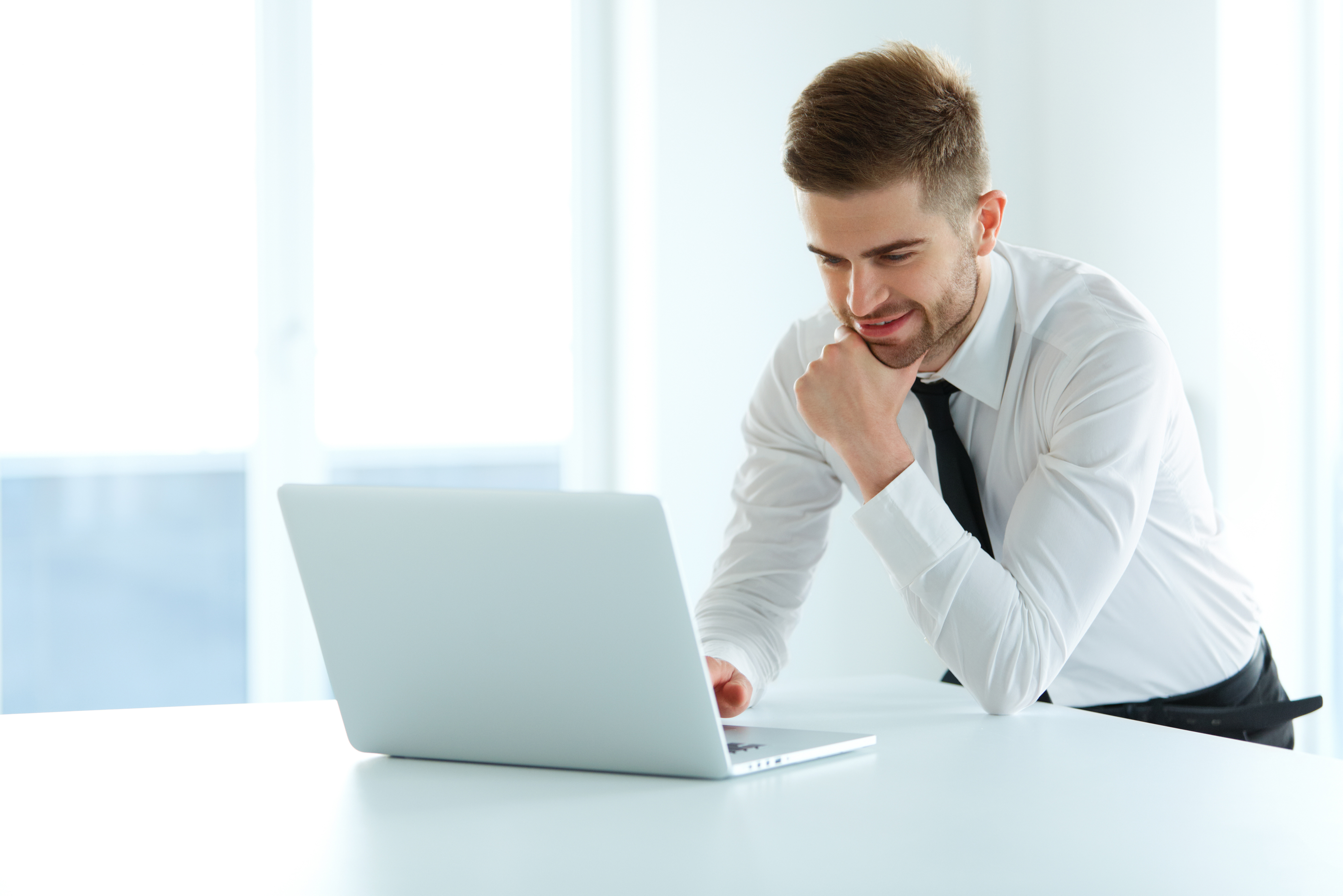 Handsome Businessman Working on Laptop at His Office